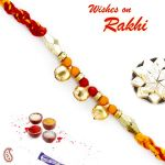 Aapno Rajasthan Red & Yellow Mauli Thread Rakhi With Small Golden Bells - Prs1710