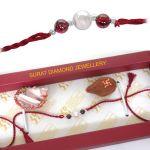 Surat Diamond Fine Real Freshwater Pearl And Lustrous Garnet Rakhi - Sngp1