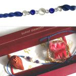 Surat Diamond Fine Pearl Rakhi Knotted With Blue Beads - Snrp1