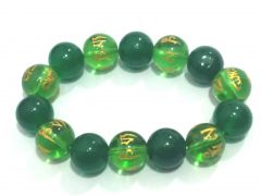 TIBETAN GREEN SYNTHETIC CRYSTALS OM MANI PADME HUM ENGRAVED STRETCH BRACELET