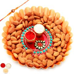 Send online Rakhi Gifts for Brother Abroad - Orange Metal Thali with Pooja Thali and Almonds with Om Rakhi