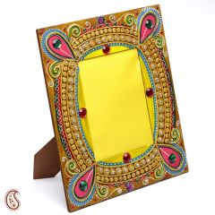 Beautiful wooden photo frame with delicate clay work