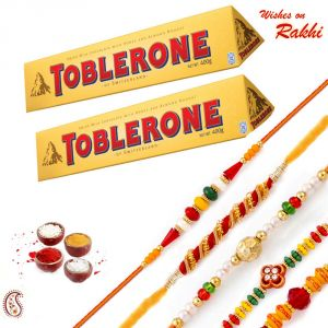 Rakhi Gift Hampers (for Brothers in India) - Delicious Pack of 2 Pc Toblerone & 5 Elegant Rakhis - HPR1759