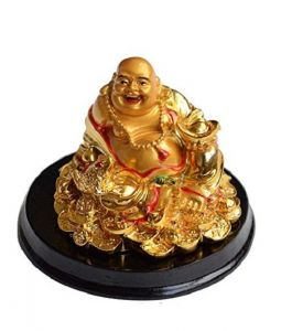 Golden Laughing Buddha Siiting On Lucky Coins For Luck And Prosperity