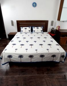 Jodhaa Double Bedsheet Set In Cotton Printed In Plain White, Blue And Brown With Blue Border Coconut Tree Print  11BSHD013