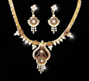 Rakhi Gifts   Jewellery (for Sisters) - 24Crt Gold Forming Heavy Party Wear Cz Diamond Set