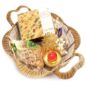 Diwali Hampers - Brown Basket With Soan Papdi, Almonds, Nutties Pouch With Om T- Lite