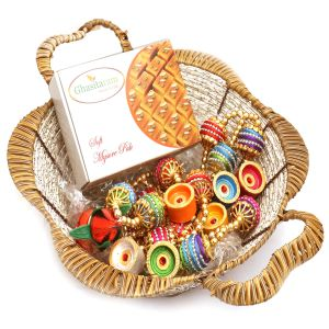 Brown Basket Basket With Mysore Pak, Toran And Diyas
