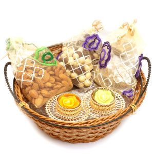Hampers - Medium Cane Basket Basket With Almonds, Roasted Almond Bites And Nutties Pouch With 2 T-lites