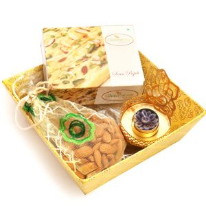 Yellow Basket Basket With Soan Papdi, Almonds Pouch With Ganesha T-lite