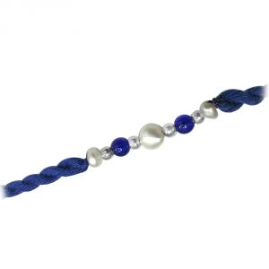 Surat Diamond A Fine Pearl Rakhi Knotted With Blue Beads (code - Snrp1)