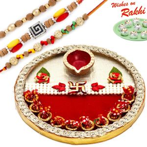 Buy Aapno Rajasthan Floral & Swastik Motif Thali Hamper With Set Of 3 Rakhis - Hpr1715 online