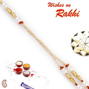 Buy Aapno Rajasthan Golden Cylindrical Beads Pearl Rakhi - Prl17555 online