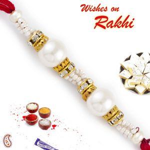 Buy Aapno Rajasthan Ad Studded Pretty Twin Pearl Rakhi - Prl17565 online