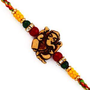 Buy Rakhi For Uae- Aapno Rajasthan Ganesh Motif Mauli Rakhi With Colorful Beads - Uae_prs1701 online