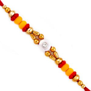 Buy Rakhi For Uae- Aapno Rajasthan Red & Yellow Beads Lovely Mauli Thread Rakhi - Uae_prs1761 online