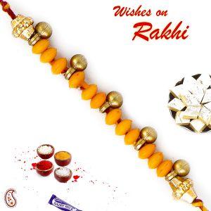Buy Aapno Rajasthan Yellow Beads Rakhi With Sweet Little Bells - Rb17631 online