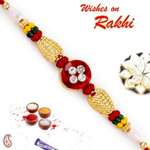 Buy Rakhi For Usa- Aapno Rajasthan Aapno Rajasthan Solid Golden Beads & Ad Studded Rakhi - Us_rb17681 online