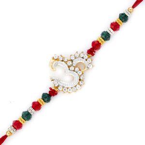 Buy Rakhi For Uae- Aapno Rajasthan Green & Red Crystal Beads Om Motif Rakhi - Uae_rj17245 online