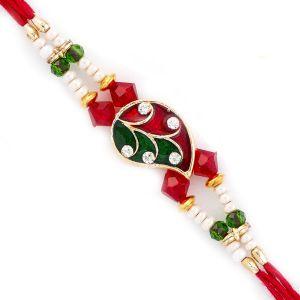 Buy Rakhi For Uae- Aapno Rajasthan Red & Green Beautiful Leaf Shape Rakhi - Uae_rj17327 online