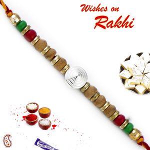 Buy Aapno Rajasthan Sandalwood Rakhi With Magenta & Green Beads - Sw17656 online