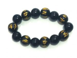 Buy Tibetan Black Synthetic Crystals Om Mani Padme Hum Engraved Stretch Bracelet online