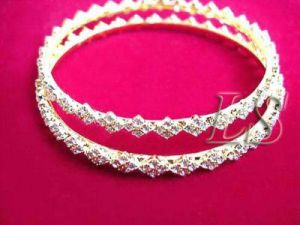 Buy 22crt Gold Forming Sleek American Diamond Bangles online