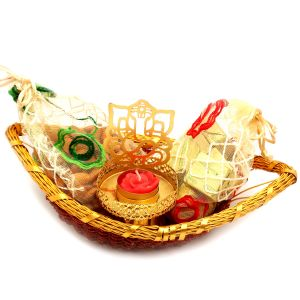 Buy Hampers - Boat Basket With Almonds, Chocolate Pouches And Ganesha T- Lite online