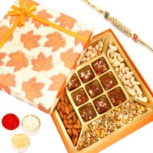 Buy Rakhi Healthy Hampers - Orange Print Almonds, Cashews, Pistachios, Roasted Protein Mix And 9 PCs Sugarfree Figs And Dates Bites With Diamond Rakhi online