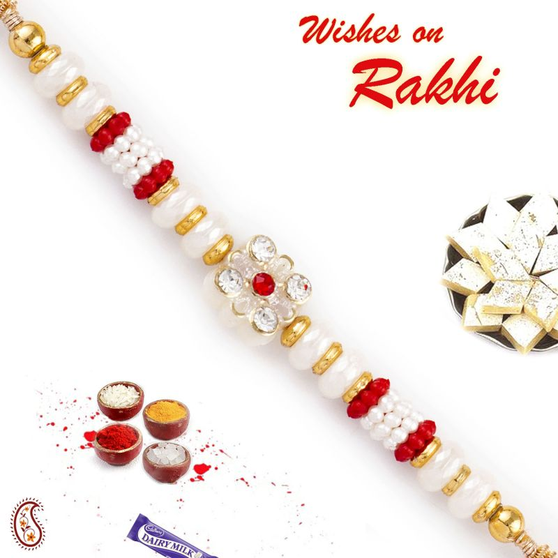 Buy Aapno Rajasthan Solid Beads & Ad Studded Pearl Rakhi - Prl17571 online