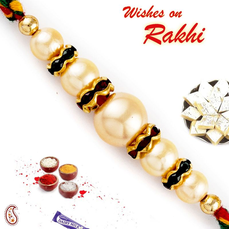 Buy Rakhi For Abroad_aapno Rajasthan Shinning Pearl Rakhi Embellished With Golden Beads - Int_prl17575 online