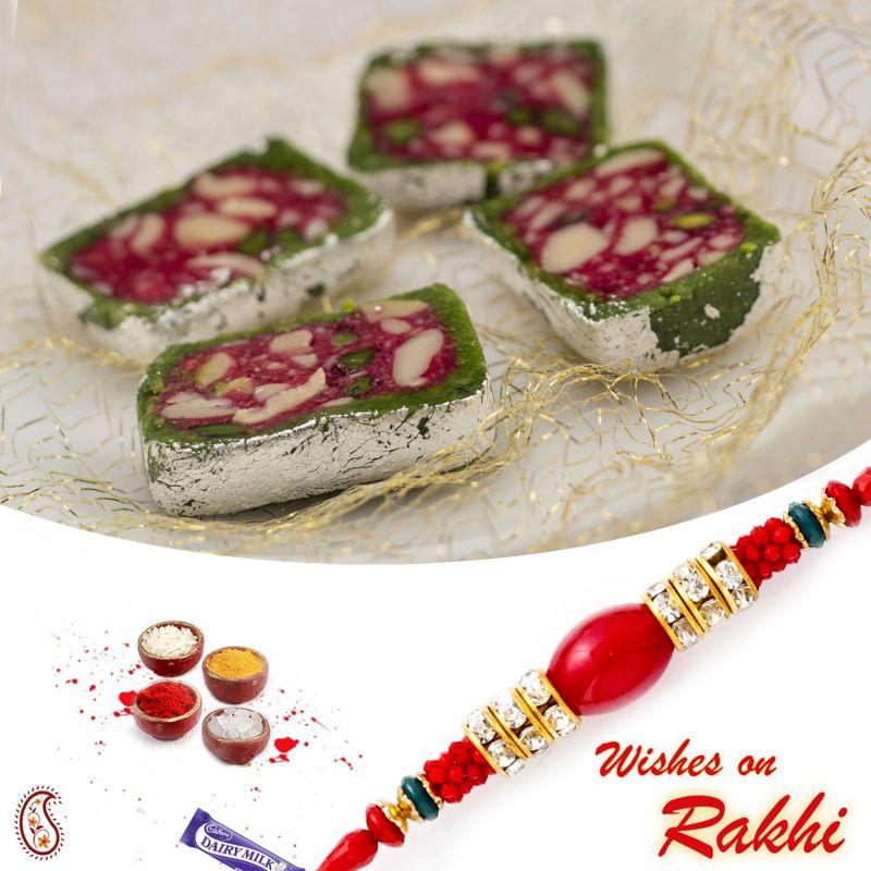 Buy Rakhi For Usa- Aapno Rajasthan Pista Toss Sweet With Free 1 Bhaiya Rakhi - Us_rm1751 online
