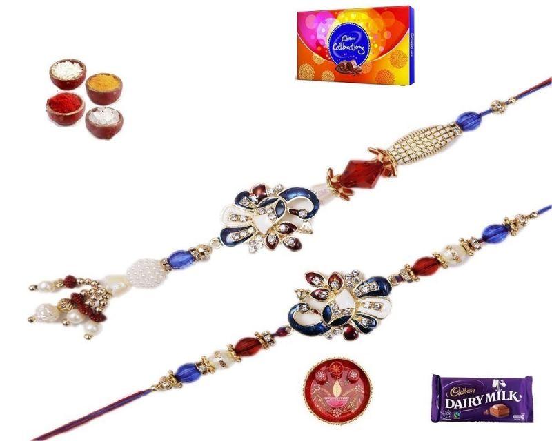 Buy Rakhi Gifts To India-stylish Peacock Bhaiya Bhabhi Rakhi Set (product Code - Mo36001) online