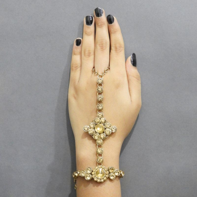 Buy Jewelmaze Gold Plated Brown Glass Stone Chain Hand Harness( Code - Faj0124) online