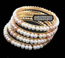 Buy Designer Wear Pearl Bangles online