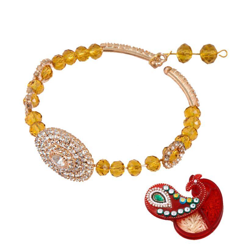 Buy Rakshabandhan Golden Charm Bracelet Design Lumba Rakhi For Bhabhi online