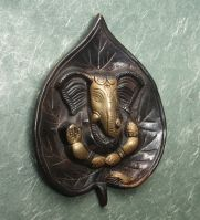 Buy Brass Wallhanging Showpiece Of Lord Ganesha On A Palm Leave online