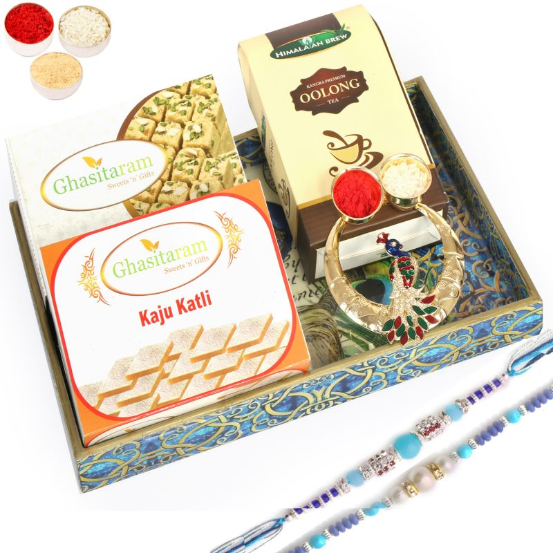 Buy Peacock Tray Sweets And Tea Hamper With 2 Rakhis online