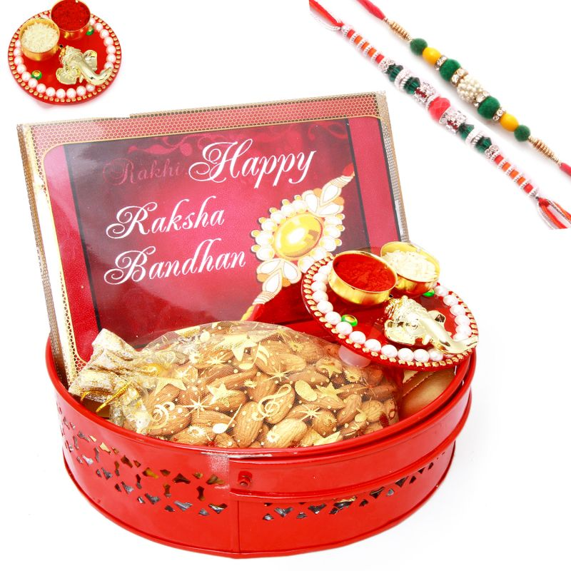 Buy Rakh N Chocolates For Brother Abroad - Big Red Metal Basket Hamper Of Happy Rakhi Chocolate, Almonds, Mini Pooja Thali And Set Of 2 Rakhis online
